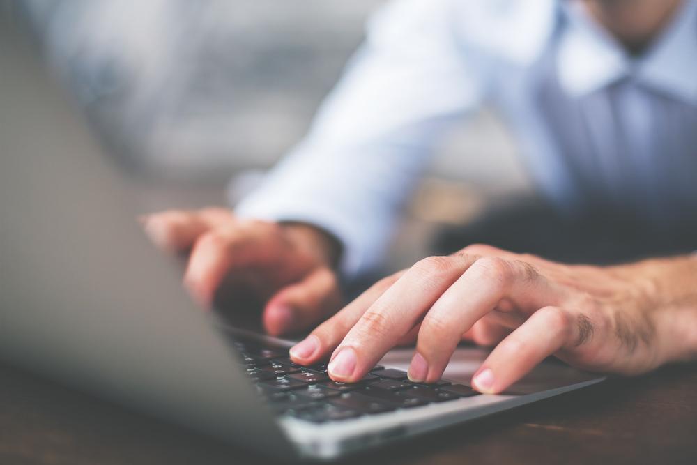 man-typing-on-laptop.jpg